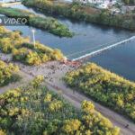 Exclusive: Drone Captures Second, Huge Haitian Caravan Smashing Across Texas Border